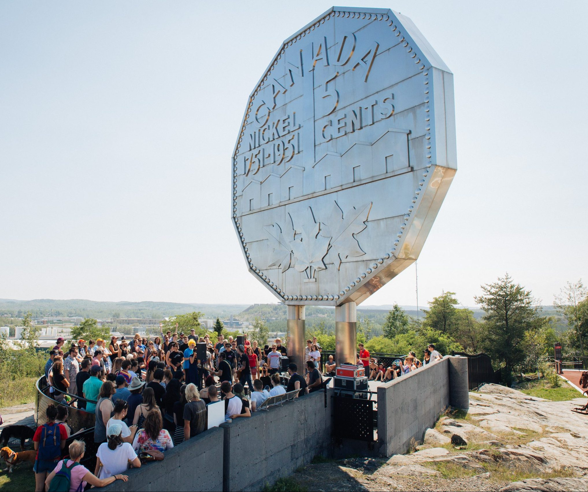 Pop-up concert under the Big Nickel during Up Here festival. Photo by Vanessa Tignanelli.
